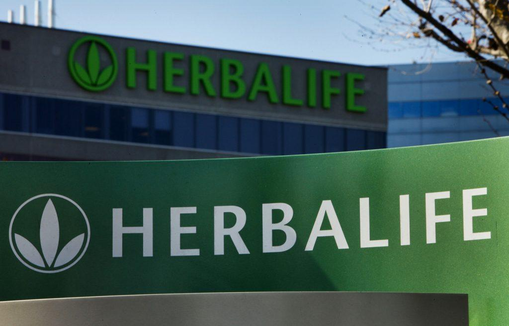 Herbalife Ltd. signage is displayed outside of the company's corporate headquarters in Torrance, California, U.S., on Thursday, Jan. 10, 2013. Daniel Loeb is squaring off against Bill Ackman over the future of Herbalife Ltd. By taking an 8.2 percent stake in the direct seller of nutrition shakes, Loeb?s Third Point LLC is the latest firm to reject hedge fund manager Ackman?s theory that Herbalife is a pyramid scheme. Photographer: Patrick Fallon/Bloomberg via Getty Images
